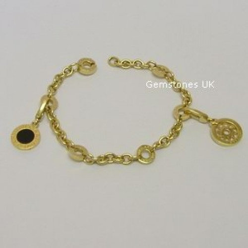 bvlgari 18ct gold charm bracelet 2 charms