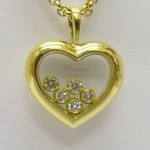 Chopard 18ct gold 5 stone happy diamonds pendant